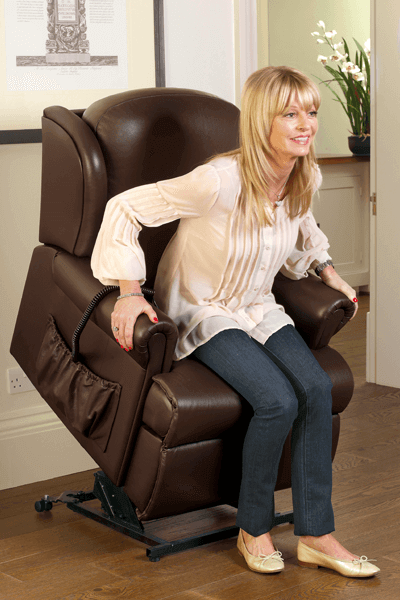 Woman sitting in her rising recliner chair