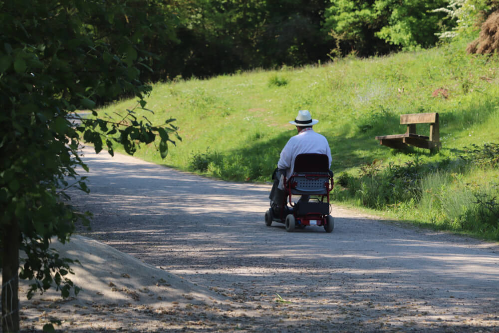 Man drives his electric wheelchair in the country