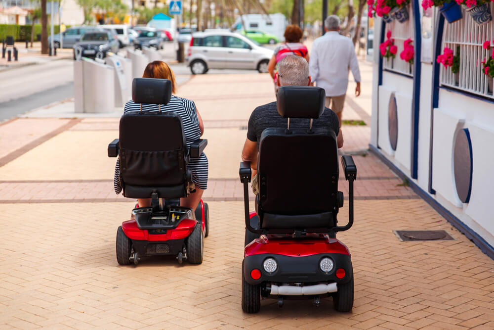 Man and woman using their electric scooters